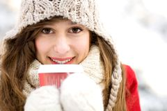 Woman holding hot coffee on winter day Royalty Free Stock Photography