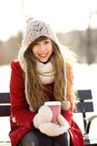 Woman holding hot coffee on winter day Royalty Free Stock Photos