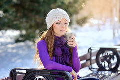 Woman holding hot coffee on winter day Stock Photo