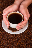 Woman holding hot cup of coffee Stock Images