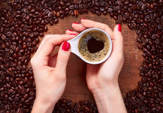 Woman holding hot cup of coffee. With heart shape Stock Image