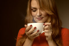 Woman holding hot cup Stock Photography