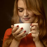 Woman holding hot cup Royalty Free Stock Image