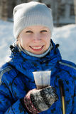 Woman holding hot drink. Outside in the winter stock photos