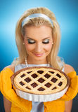 Woman holding hot italian pie Royalty Free Stock Image
