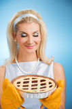 Woman holding hot italian pie Royalty Free Stock Images