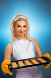 Woman holding hot roasting pan Royalty Free Stock Image