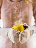 Woman holding hot steaming coffee cup close up photo Royalty Free Stock Images
