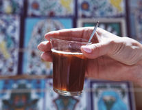 Woman holding hot tunisian tea Royalty Free Stock Photos