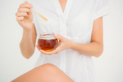 Woman holding hot wax in bowl Royalty Free Stock Image
