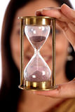 Woman holding hour glass Royalty Free Stock Photo