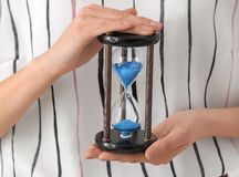 Woman holding hourglass, closeup. Time management concept royalty free stock images