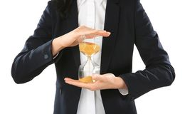 Woman holding hourglass on white background. Time management concept royalty free stock image