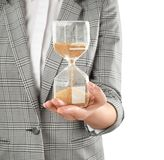 Woman holding hourglass on white background. Time management concept stock images