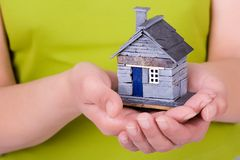 Woman_holding_house_01 Royalty Free Stock Photography