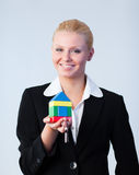 Woman holding a house. And keys Stock Photo
