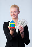 Woman holding a house Stock Image