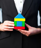 Woman holding a house Stock Images