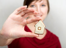 Woman holding house royalty free stock photos