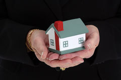 Woman Holding House Stock Photos