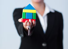 Woman holding house and dollars. Young Businesswoman holding house and keys Stock Photography