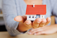 Woman holding house on hand Royalty Free Stock Photo