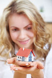 Woman holding house in her hands royalty free stock photography