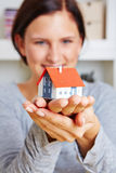 Woman holding house on her hands royalty free stock photography