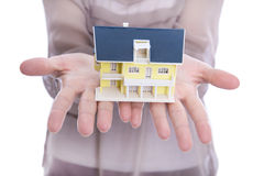 Woman holding a house in her hands. Royalty Free Stock Image