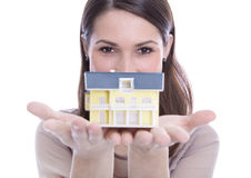 Woman holding a house in her hands. Stock Photography