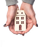 Woman holding house or home maquette Royalty Free Stock Photos