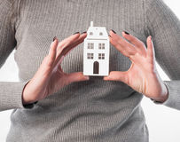 Woman holding house or home maquette Royalty Free Stock Photography