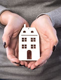 Woman holding house or home maquette Royalty Free Stock Images
