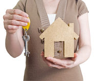 Woman holding house and keys Royalty Free Stock Photography