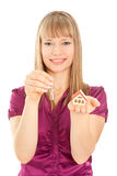 Woman  holding house and keys (focus on woman). Picture of woman  holding house and keys isolated (focus on woman Royalty Free Stock Images