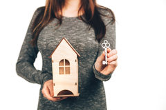 Woman holding house and keys in her hands Royalty Free Stock Photos