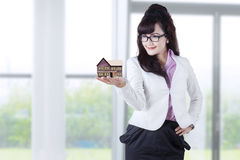 Woman holding house miniature Stock Photos