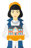 Woman holding house model. Stock Images