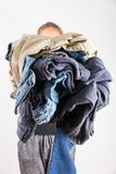 Woman holding huge pile of dirty clothes stock images