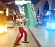 Woman holding huge shopping bag Royalty Free Stock Photos