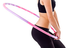 Woman holding hula hoop Royalty Free Stock Photography