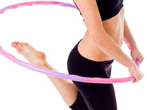 Woman holding hula hoop Royalty Free Stock Image