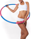 Woman holding hula hoop Stock Images