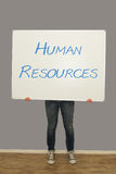 Woman holding human resources sign Royalty Free Stock Photos