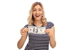 Woman holding a hundred dollar bill. Happy woman holding a hundred dollar bill isolated on white background Royalty Free Stock Photo
