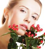 Woman holding Hypericum flowers Stock Photos