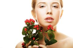 Woman holding Hypericum flowers Royalty Free Stock Images