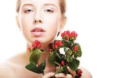 Woman holding Hypericum flowers Royalty Free Stock Photography