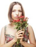 Woman holding Hypericum flowers Stock Photography