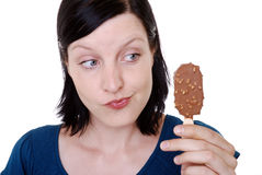 Woman holding ice cream bar Stock Photo